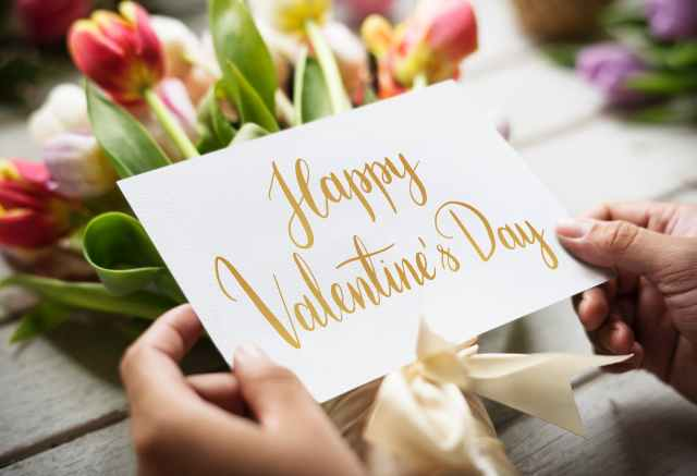person holding happy valentine s day card